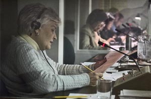 Interpreters in their sound-proof interpreter booths. Image credit: www.un.org